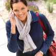 Stock Photo: Smiling woman talking phone calling elegance businesswoman