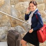 Smiling woman talking phone business traveling rushing — Stock Photo