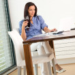 Woman student doing research living working room - Stockfoto