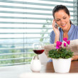 Smiling woman talking mobile phone relaxing reading — Stock Photo