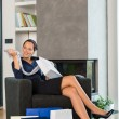 Woman looking clothes gift sale living room — Stockfoto