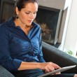 Young businesswoman using digital tablet — Stockfoto