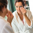 Young woman cleaning face cotton pads bathrobe — Foto de Stock