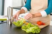 Woman preparing salad vegetables kitchen cooking food — Stock Photo