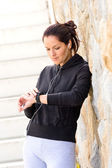 Young woman checking after exercising sport sweatsuit — Stock Photo