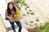 Young woman arriving home groceries shopping smiling — Stock Photo