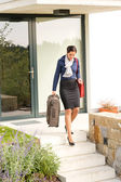 Young businesswoman rushing luggage going busy traveling — Stock Photo
