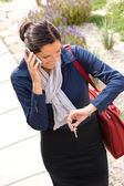 Woman calling rushing arriving home business phone — Stock Photo