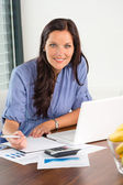 Happy businesswoman working office writing calculating finance — Stock Photo