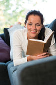 Female student studying couch home bookworm woman — Stock Photo