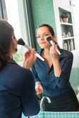 Young woman applying face powder bathroom brush — Stock Photo