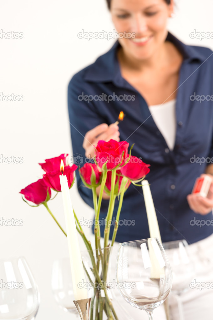 Young woman lighting candle lunch romantic love red roses — Stock Photo #19055415