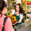Colorful bouquet florist woman selling customer flower — Stock Photo