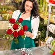 Woman florist working flowers roses market making  — 图库照片