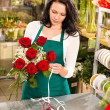 Stock Photo: Woman florist working flowers roses market making