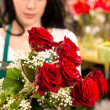 Stock Photo: Young woman making flower bouquet florist shop