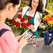 Woman customer paying flowers shop credit card — Stock Photo