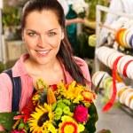 Smiling young florist woman colorful bouquet shop — Stock Photo