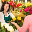Cheerful flower shop florist customer buying yellow — Stock Photo #19857725