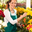 Cheerful woman flower shop market choosing working — Stock Photo