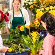 Royalty-Free Stock Photo: Florist woman preparing bouquet customers flower shop