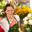 Smiling florist flower shop colorful making bouquet — Stock Photo #19857787