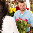 Husband buying roses bouquet romantic flower market — Stock Photo #19857831
