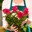 Stock Photo: Female holding bouquet flowers roses flower shop