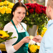 Smiling florist man customer buying flowers card — Stock Photo
