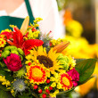 Colorful bouquet flowers florist holding flower market — Stock Photo #19857859
