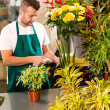 Man florist reading price barcode reader flower — Stockfoto