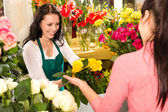 Cheerful flower shop florist customer buying yellow — Stock Photo