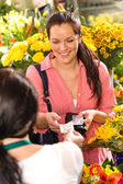 Woman customer taking receipt flower shop buying — Stock Photo