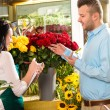 Man customer ordering flowers bouquet flower shop - Foto de Stock