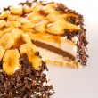 Banana dessert cake with dark chocolate topping — Stockfoto