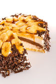 Banana dessert cake with dark chocolate topping — Stock Photo