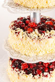 Wedding cake white chocolate and red berries — Stock Photo
