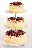 Three-story cake almond with red berries — Stock Photo