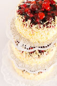 Stacked cake red berries and almonds — Stock Photo