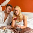 Smiling couple bed breakfast celebrating Valentine&#039;s - Stockfoto