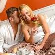 Romantic couple cuddling bed motel celebrating anniversary — Stock Photo