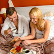 Eating romantic breakfast bed smiling couple Valentine's — Stock Photo