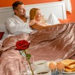Romantic breakfast hotel room service young couple — Stock Photo