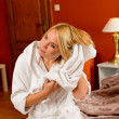 Happy woman bed room drying hair towel - Stock Photo