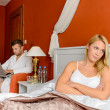 Stock Photo: Upset girl sitting bed after fight boyfriend