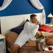 Romantic hotel room young couple sexy nightgown - Stock Photo