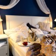 Rumpled sheets hotel bedroom romantic night — Stockfoto