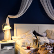Empty unmade luxury bed romantic feeling champagne — Stockfoto