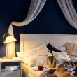 Empty unmade luxury bed romantic feeling champagne — ストック写真
