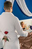 Man seducing flirting affair mistress rose bedroom — Stock Photo